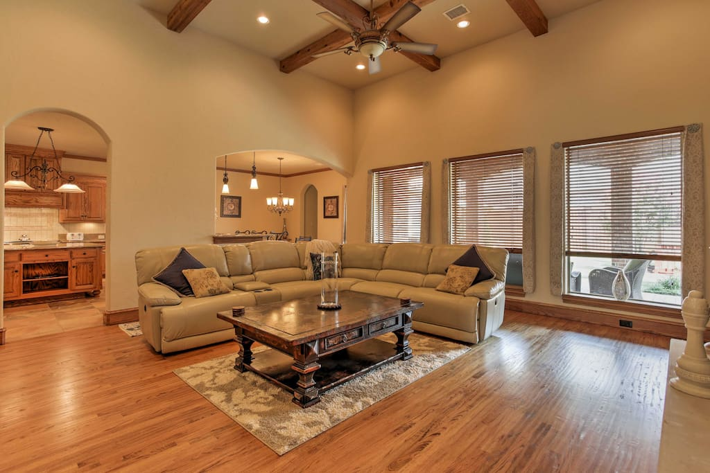 Inside, hardwood flooring meets your feet, while high ceilings open up each room.