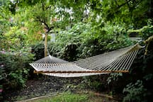 Stare up at the trees above you as you relax in the hammock!