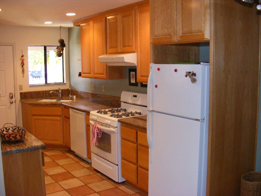 Full kitchen with dishes, pots / pans, etc.