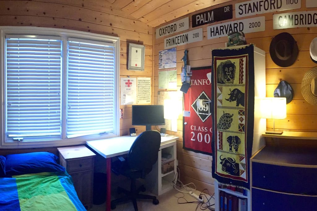 Panorama of room, includes built in sliding closet, shelves, and dresser.