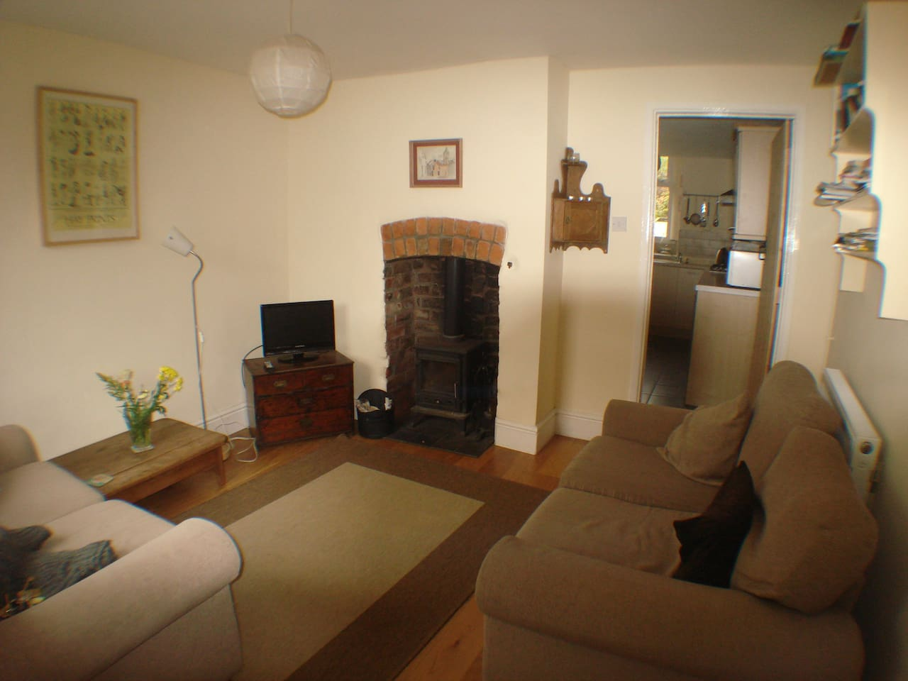 Cosy lounge with wood burning stove, TV with DVD and CD facility, two 2 seater sofas, lamps and many books and maps of the area and a particularly chilling DVD of the Hay murders!