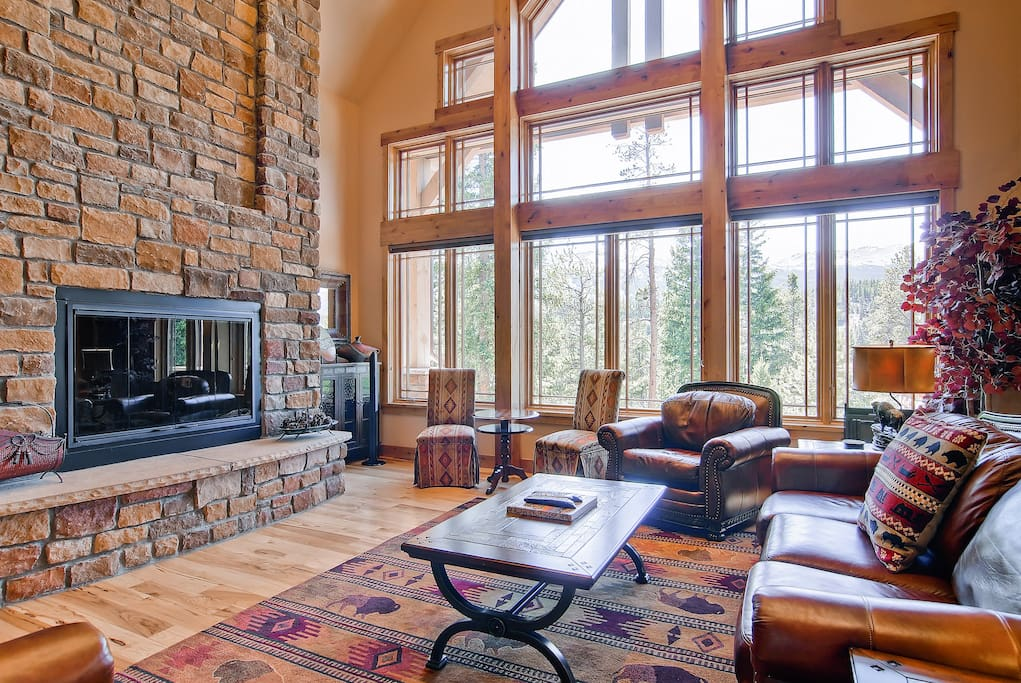 What's most dramatic, the soaring stone fireplace, gorgeous view of the mountains, or the stunning windows?