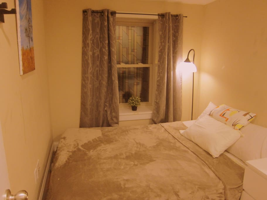 Queen bed with memory foam mattress accommodate 1 person ONLY. view at night