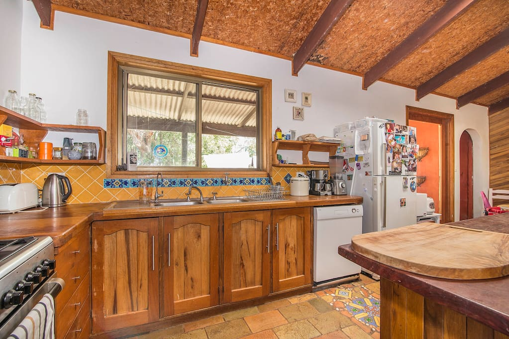 Kitchen area with stainless steel 5 burner gas cooker and big timber island bench