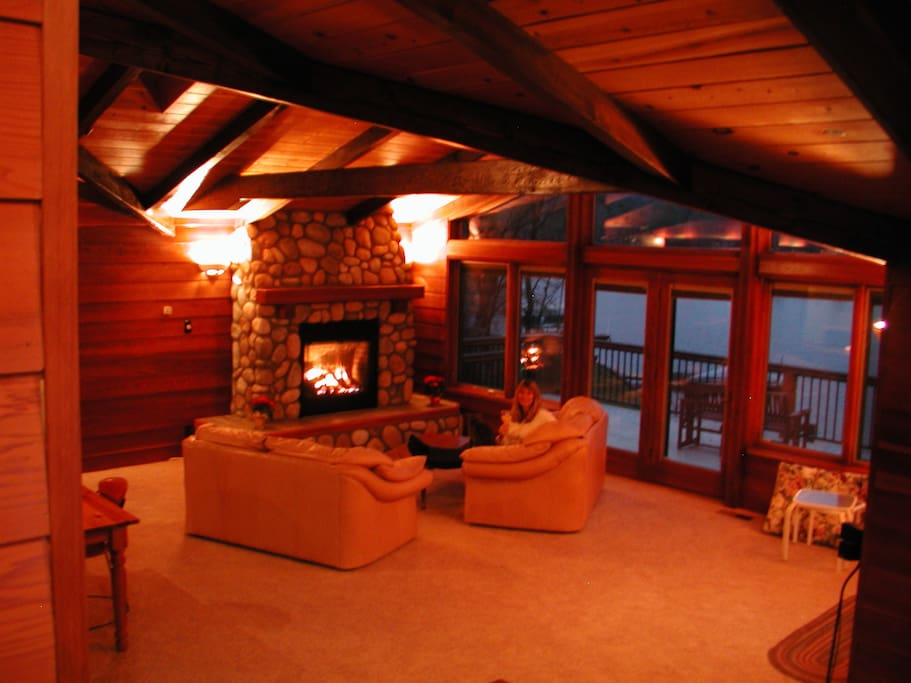 Huge great room with Tahoe RiverRock gas fireplace, includes den, dining area and open kitchen with full lake views