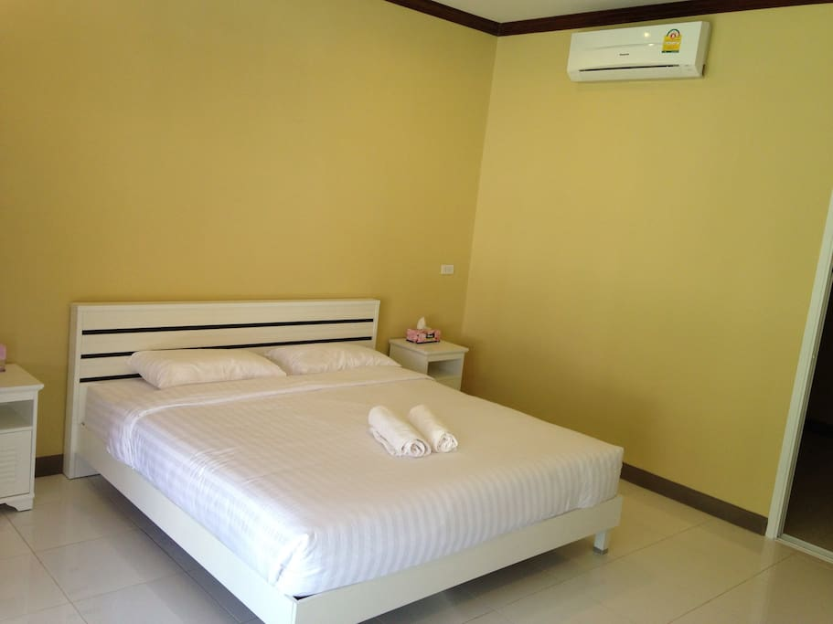 Large Bedroom with Sofa and Sony TV