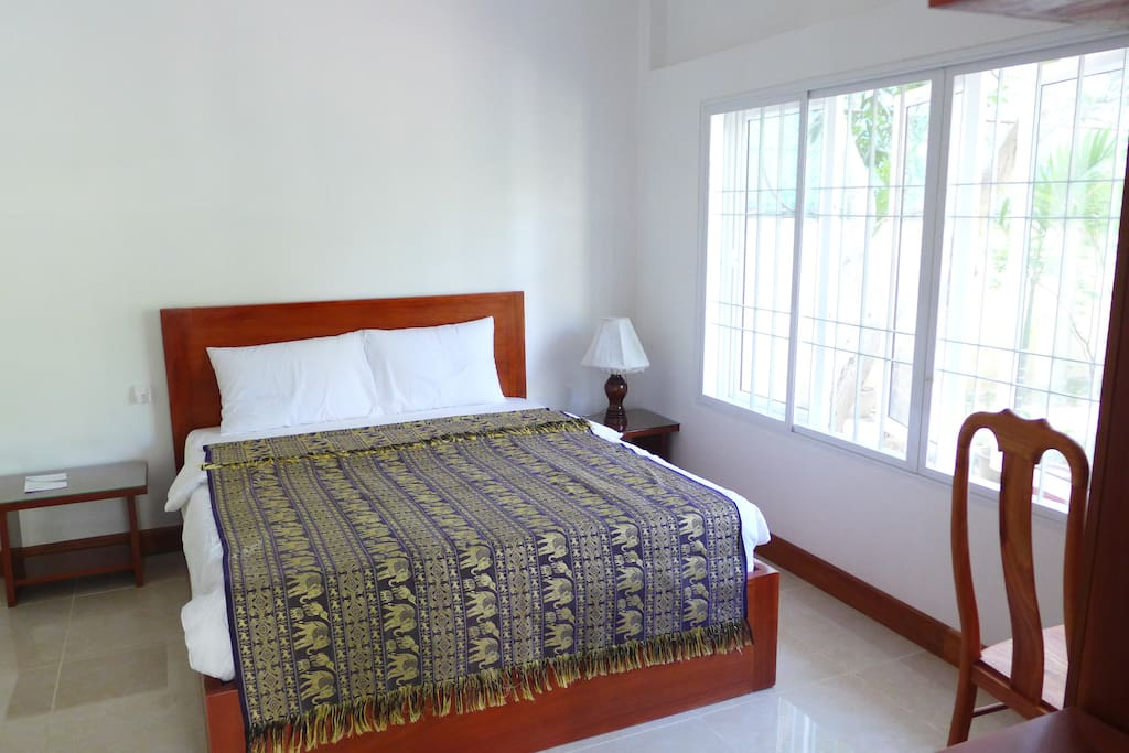 Master bedroom with double bed and private bathroom