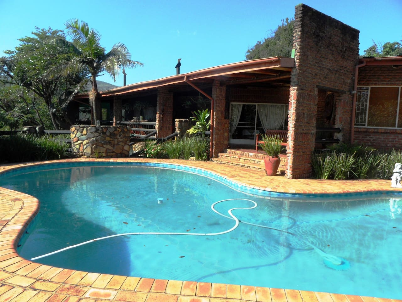 The house overlooks a sparkling pool