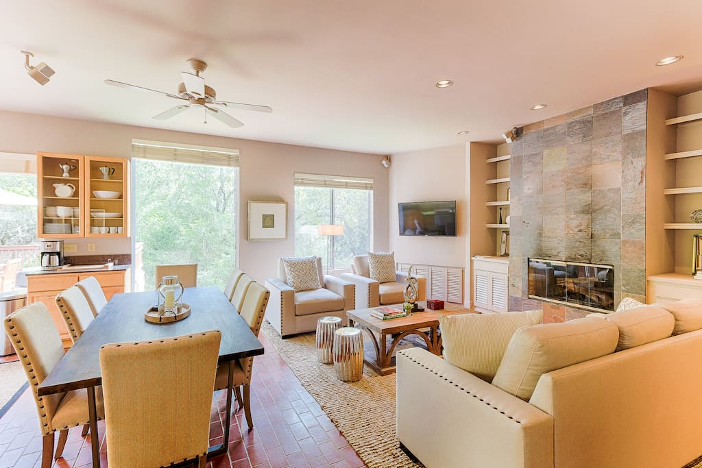 On cool nights, the living room's centerpiece gas fireplace creates a warm ambiance for lounging on the couch and two arm chairs.