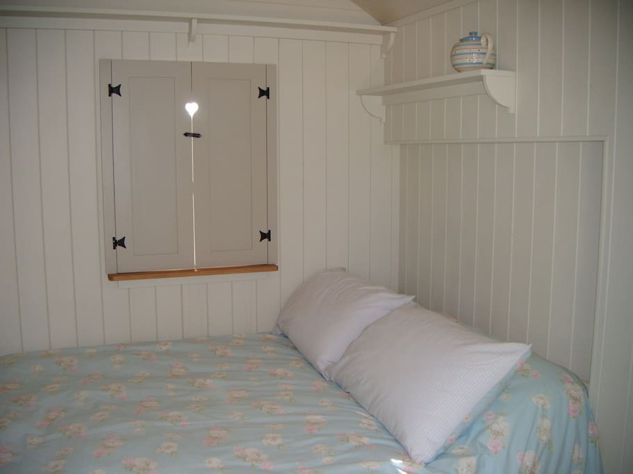 Double bed, shuttered windows......