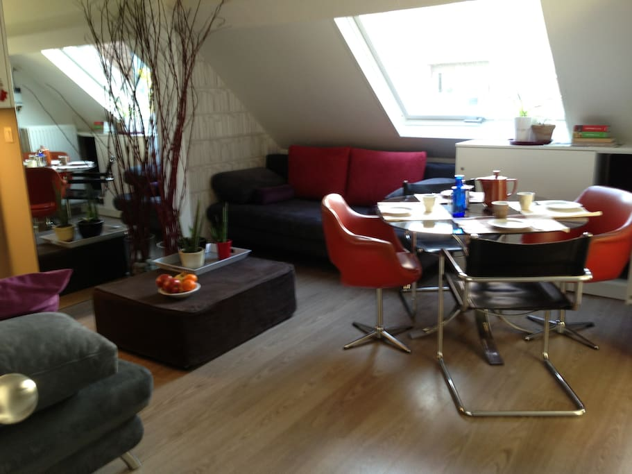 living/dining room + kitchen corner, access to the terrace