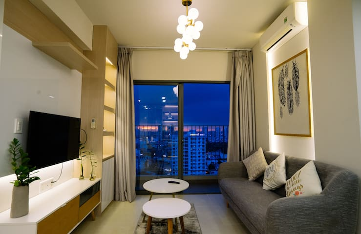 Living room with big balcony where you can have a magnificent view to District 1, Vinhomes Central Park and Landmark 81.