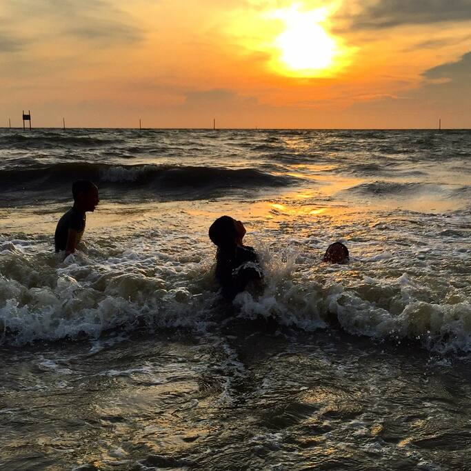 Children enjoying the waves