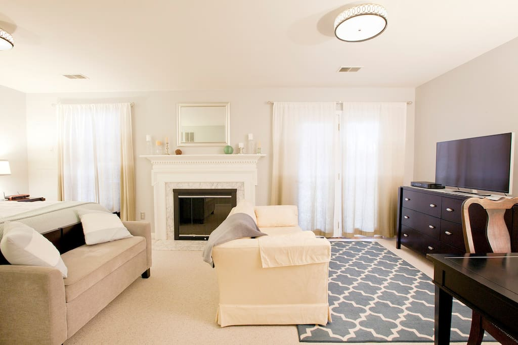 cozy sitting area with a sleek 40 inch LED TV with DVR to record your favorite programs