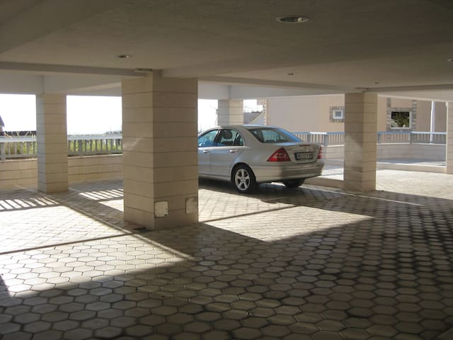 Apartment has private parking lot.