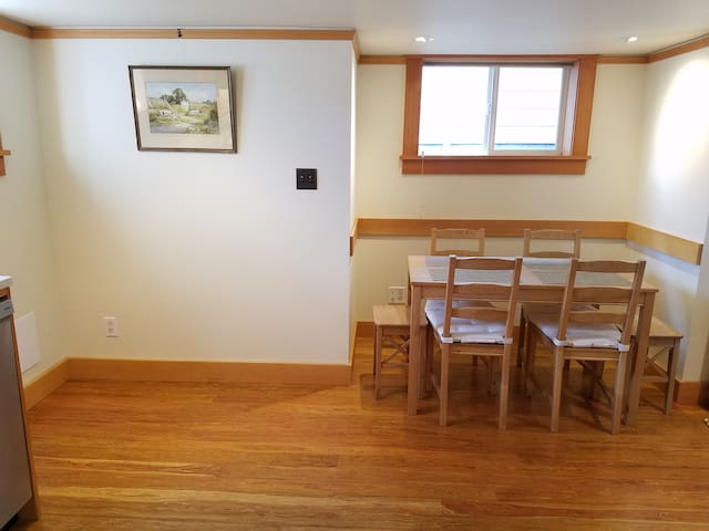 Cute dining room that can accommodate six. Reclaimed wood floor.