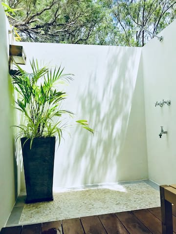 Outdoor shower has hot and cold water.