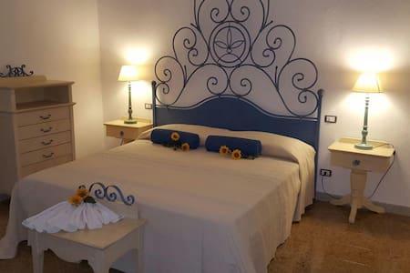 Residenza Casa Dessì stanza Giunco - Haus