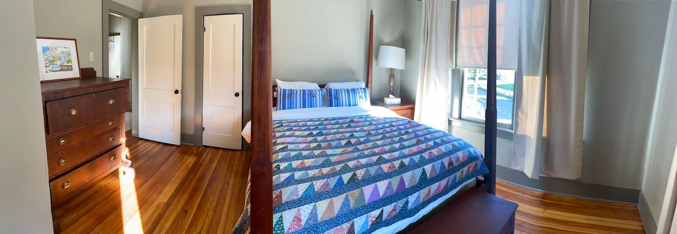 Queen sized bed in guest room.