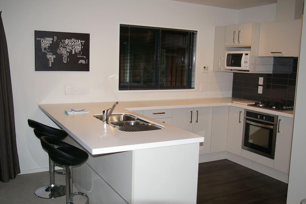 Kitchen area with modern appliances including dishwasher