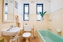Once thought the yellow & green was charming. Now I'm dying to renovate the bathroom!