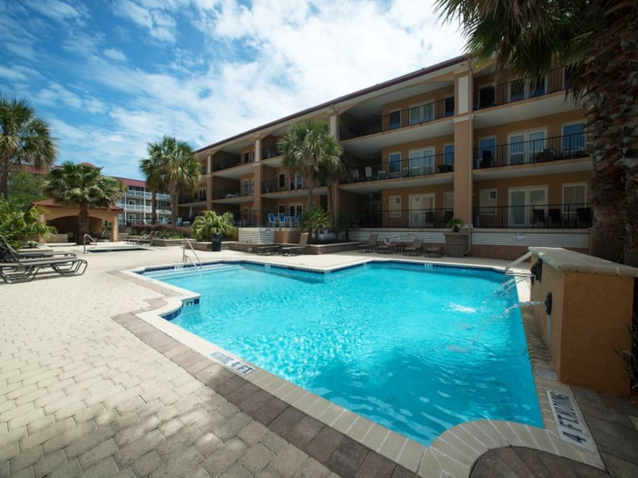 Enjoy the Swimming Pool and Spa with Abundant Deck Space, Lounge Chairs and Shaded Cabana