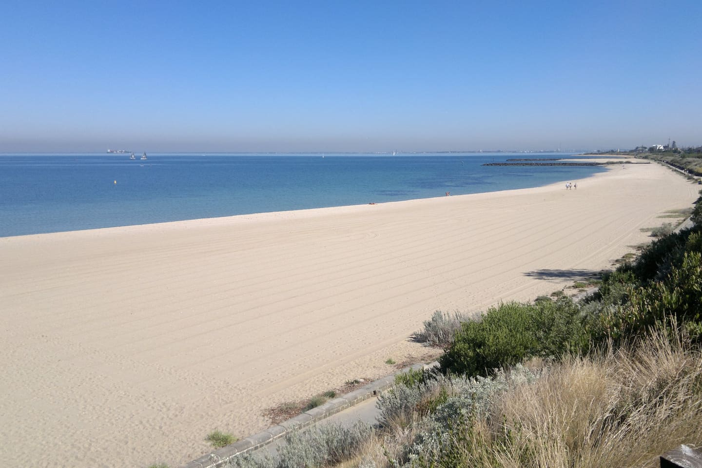 Beautiful clean white sandy beach, Palm Trees, Aqua water, fitness track only a 100m from our door step.