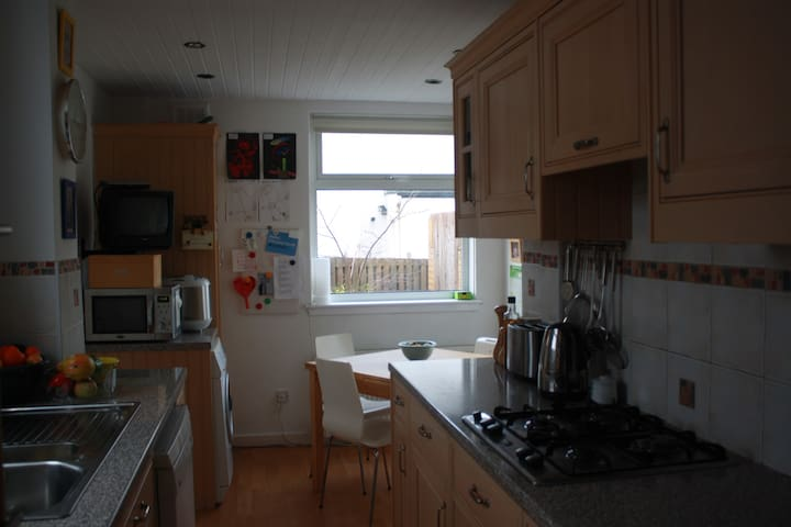 Dining kitchen with dishwasher, washing machine, microwave, bread maker, cooker and all you would need to make family meals.