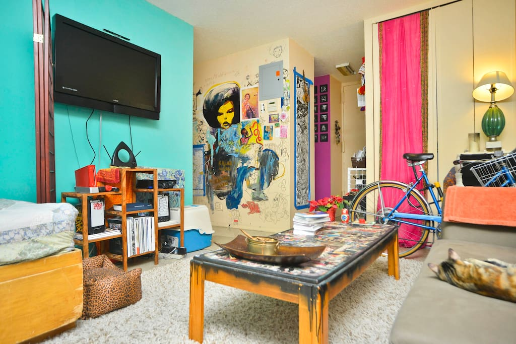 This is the living room! My mural wall is an airbnb fave!
