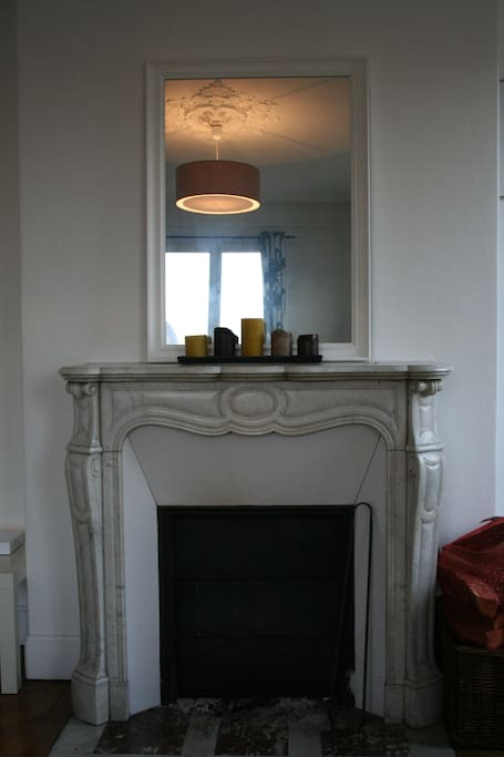 Apt has two classic fireplaces. This one is in the living room.