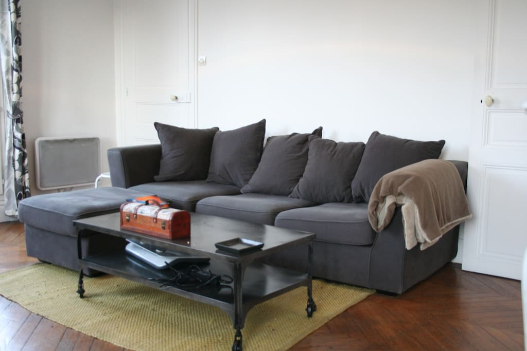 A comfy L-shaped couch that includes a pull out full-sized bed.