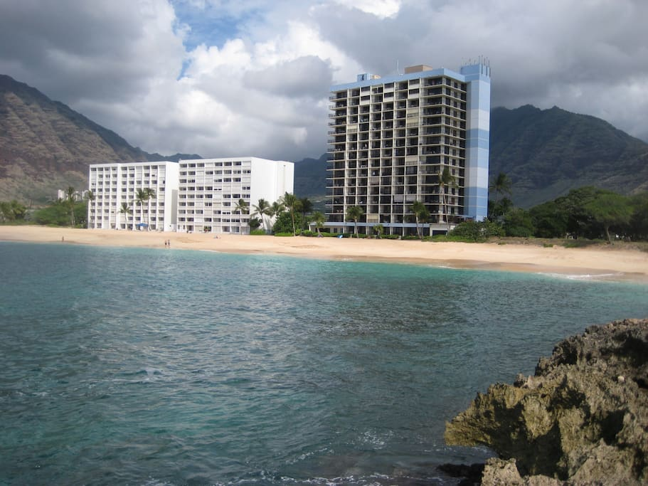 Hawaiian Princess is the tall building on right with blue trim and is on private beach.