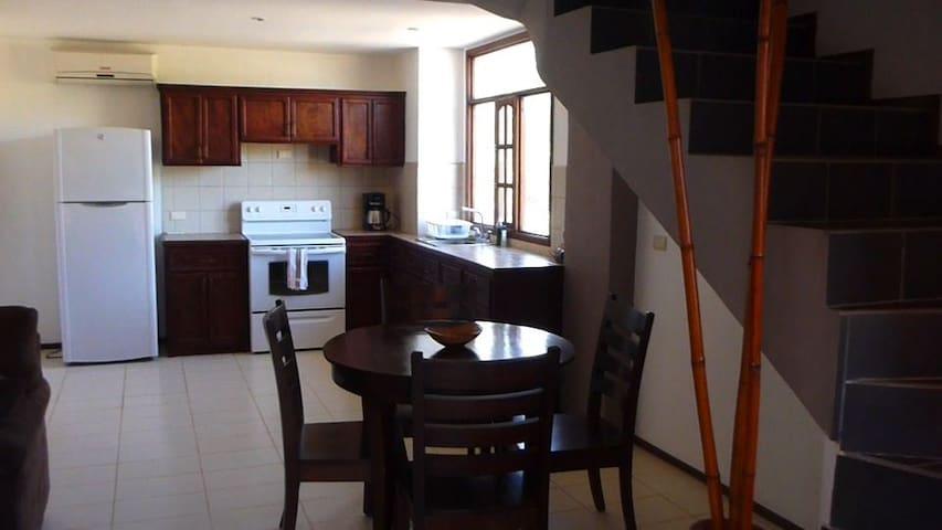 Open kitchen with super bright windows overlooking the neighbourhood