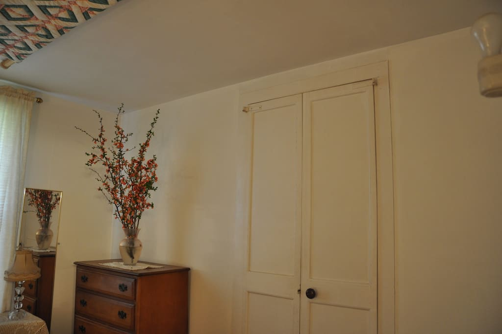 Doors from the bedroom leading to the living room