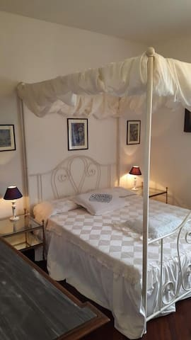 Giulia's bedroom with king size bed and private bathroom
