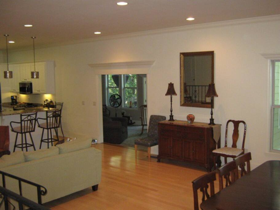 Open floor plan with kitchen and bar connected makes the house great for hosting before the game or after an event
