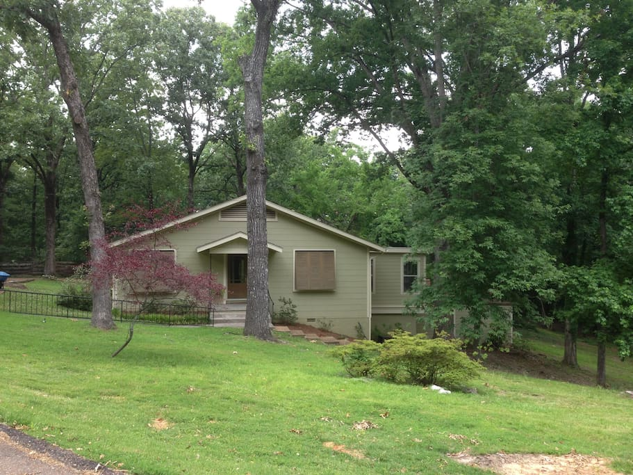 Updated 1950's house on a wooded lot walking distance to University and near the Square