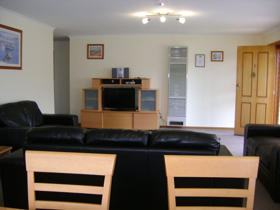 Gas wall heaters, dining table for 6 and large flat screen TV.