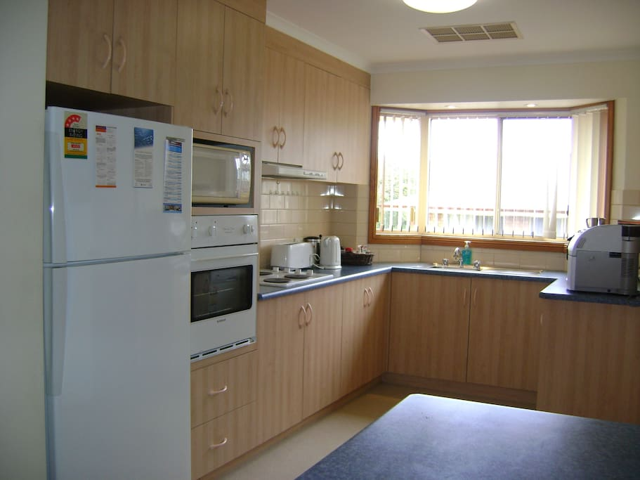 Kitchen with dishwasher, espresso coffee machine and all appliances