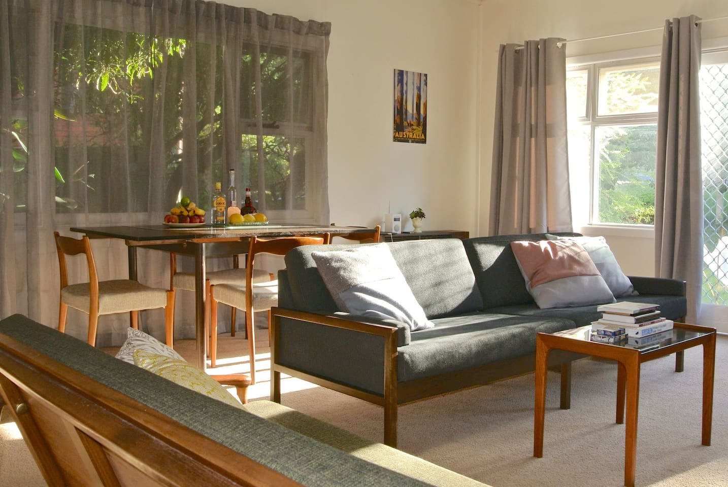 Comfortably furnished living room, with split system AC/heater unit.