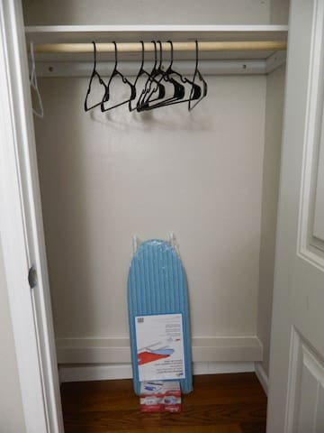 Walk-in closet has ironing board, iron, and hangers.  It is big enough to fit 4 luggage.