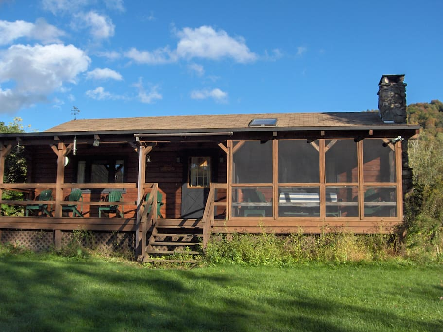 Large, screened and covered porch overlooking the East Branch of the Delaware River