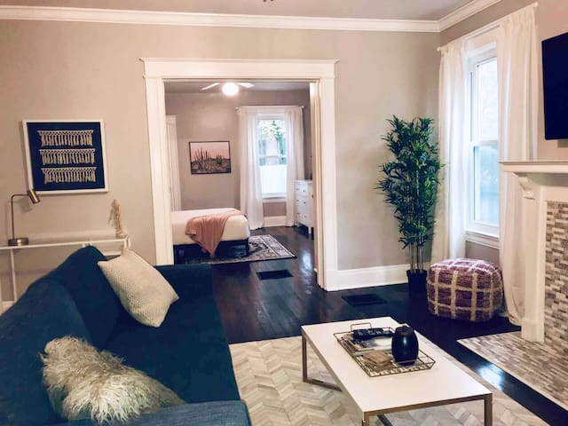 Spacious living room with pocket door to separate bedroom