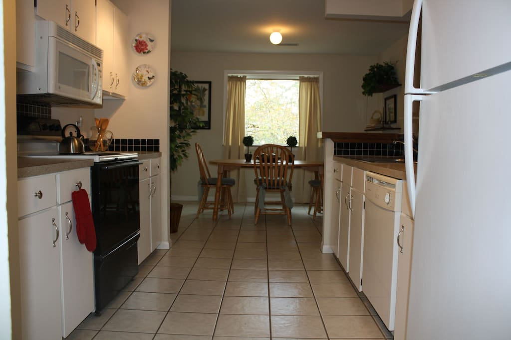 Tiled kitchen and dining area