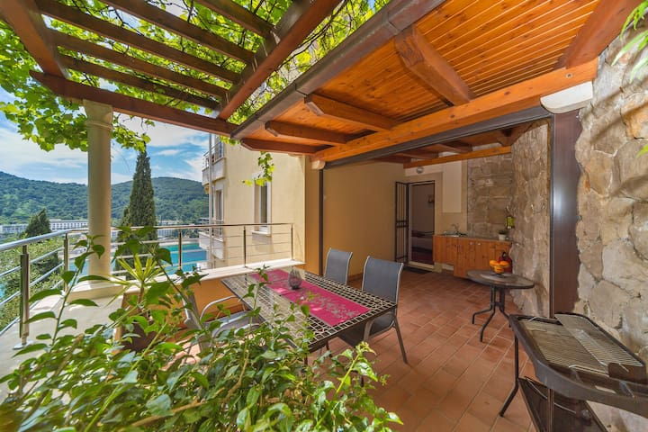 Outdoor terrace equipped with dining table, BBQ facilities
