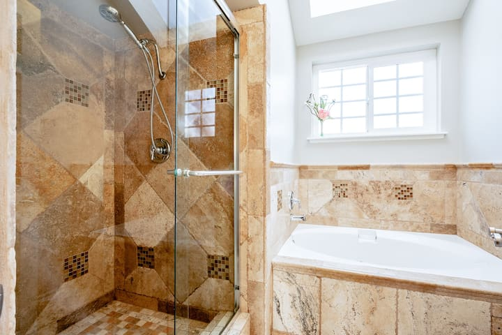 Master Bath #1 with jetted soaking tub and separate stone shower