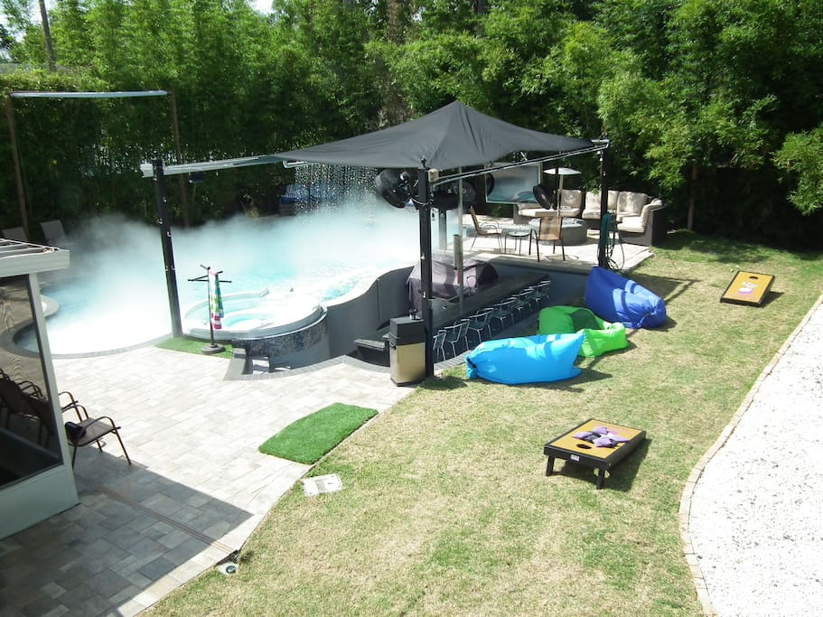 Cornhole boards, inflatable couches, pool fog to cool you off, waterfalls what more can you ask for?