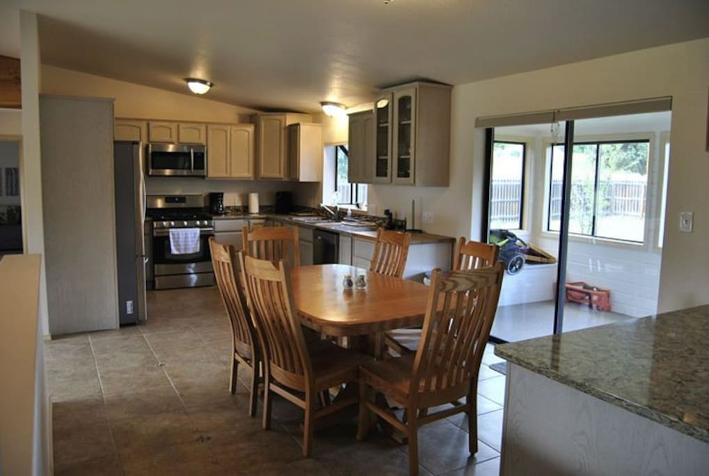 Kitchen with new appliances and expandable table.