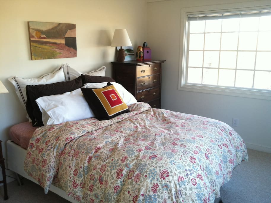 Enjoy the view from under your down comforter. Rolling fields and Carter's Mountain are just outside those windows.