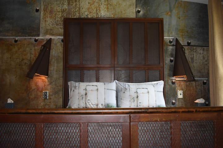 Custom Queen Bed Constructed from Recycled Materials by Perdue Studios & Printed Steel Door Shams